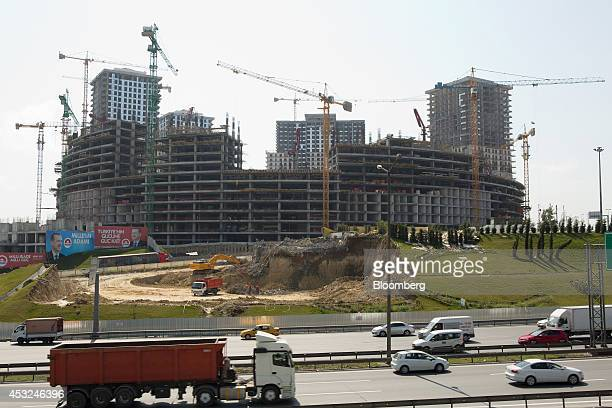 Construction cranes operate around a building project as part of the Venedik Saraylari residential and business area beside the Trans Europe Motorway...