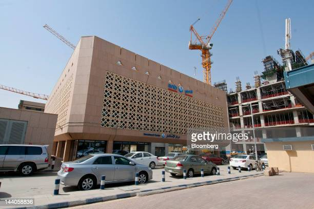 Construction cranes operate on new buildings near the offices of ANB Invest or Arab National Investment Company in Riyadh Saudi Arabia on Tuesday May...