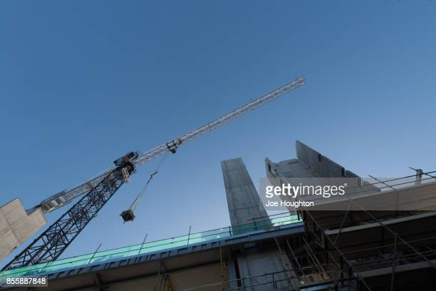 construction cranes - urban renewal stock pictures, royalty-free photos & images