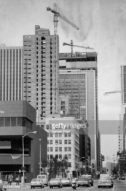 Construction Cranes Ride High Over Downtown Denver Three cranes on the skyline above 17th Street in downtown Denver attest that the core city's...