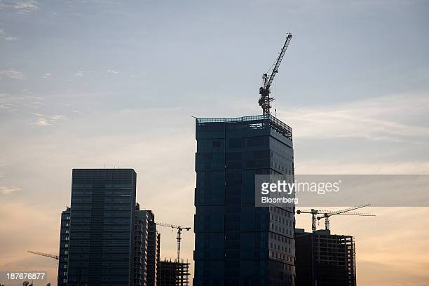 Construction cranes stand alongside commercial property under development in central Luanda Angola on Saturday Nov 9 2013 Angola the largest crude...