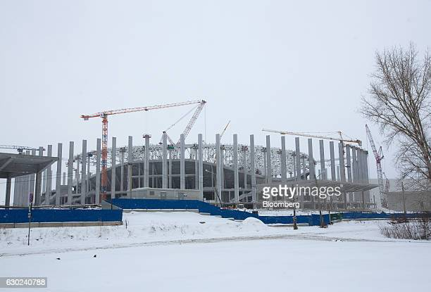 Construction cranes stand beside the Nizhny Novgorod soccer stadium in Nizhny Novgorod Russia on Sunday Dec 18 2016 Nizhny Novgorod is one of the...