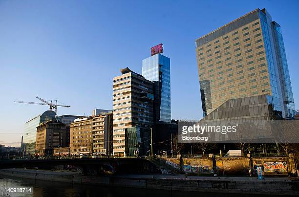Construction cranes stand near commercial properties alongside the Danube river in Vienna Austria on Tuesday March 6 2012 Austria sees no need to...