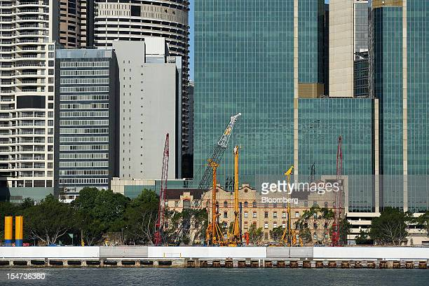 Construction cranes stand on the Barangaroo redevelopment project as commercial buildings in the central business district tower over the site in...
