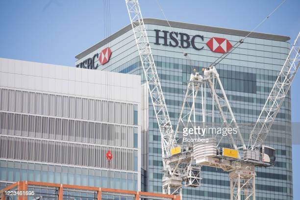 Construction cranes stand on the site of Wood Wharf a development by the Canary Wharf Group beyond the HSBC Holdings Plc building in the Canary Wharf...