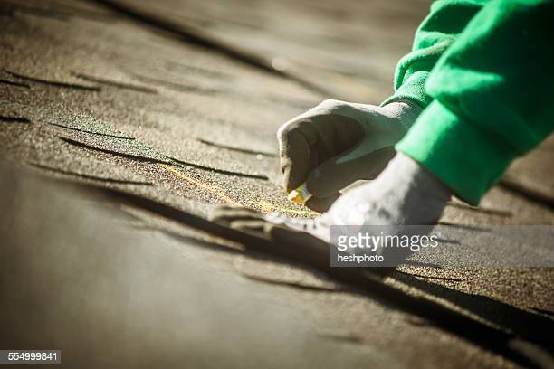construction crew member preparing roof for solar panel installation - heshphoto stock pictures, royalty-free photos & images