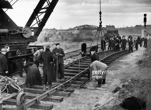 Construction crew seen here working against the clock to complete the laying of a new twin track at Dairycoates which will allow the transfer from...