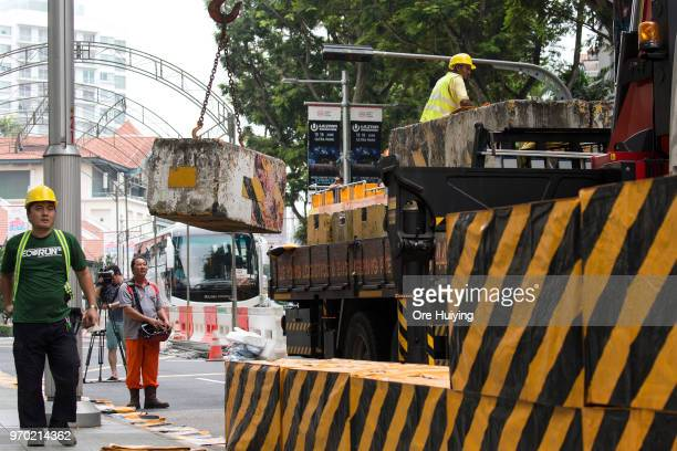 Construction crew set up barricades in front of St Regis Hotel on June 9 2018 in Singapore The historic meeting between US President Donald Trump and...