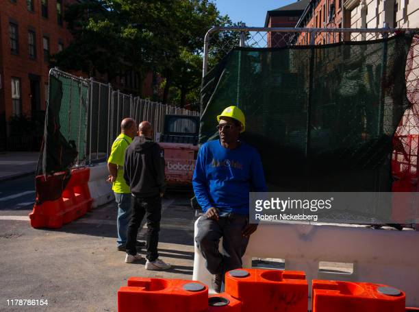 Construction crew stands outside the Polhemus Memorial Clinic Building in Brooklyn, New York on September 19, 2019. The landmark Polhemus Building,...