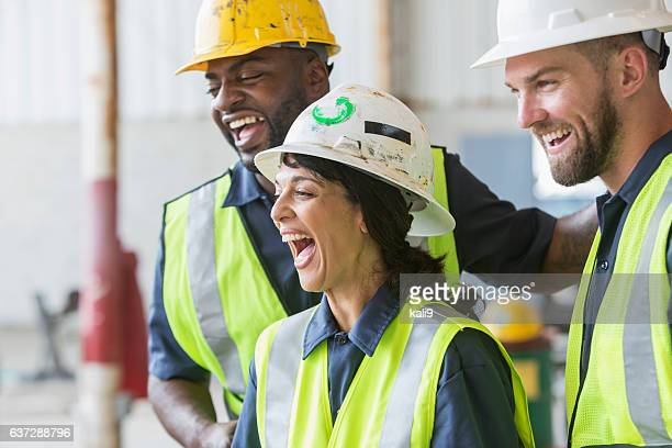 Construction crew with female boss, laughing
