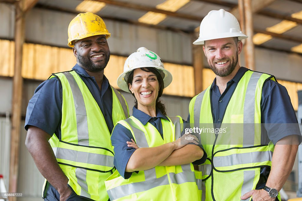 Construction crew with female boss : Stock Photo