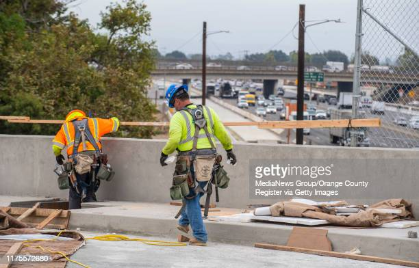 Construction crews put the finishing touches on the new Slater Avenue bridge over the 405 freeway in Fountain Valley on Wednesday, August 28 as it is...