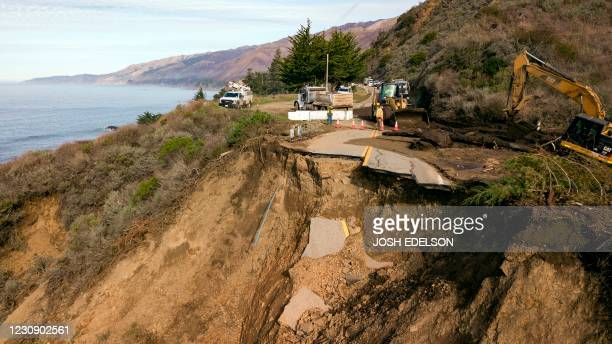 Construction crews work at the scene where a section of Highway 1 collapsed into the Pacific Ocean near Big Sur, California on January 31, 2021. -...