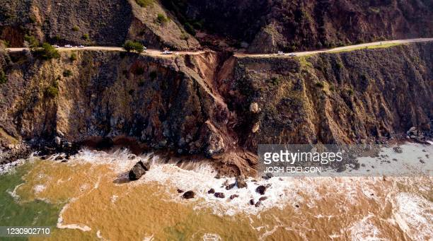 Construction crews work on a section of Highway 1 which collapsed into the Pacific Ocean near Big Sur, California on January 31, 2021. - Heavy rains...