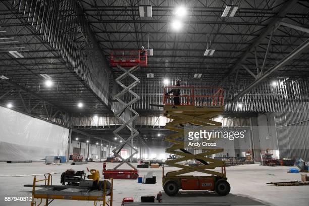 Construction crews work on the Aurora Ballroom and Exhibit Hall in the convention center of the 1500 room Gaylord Rockies Resort and Convention...