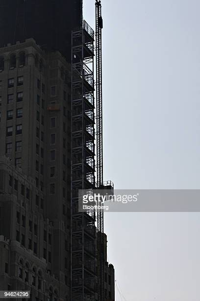 A construction elevator spanning the exterior of the former Williamsburgh Savings Bank building the tallest building in Brooklyn and a historic...