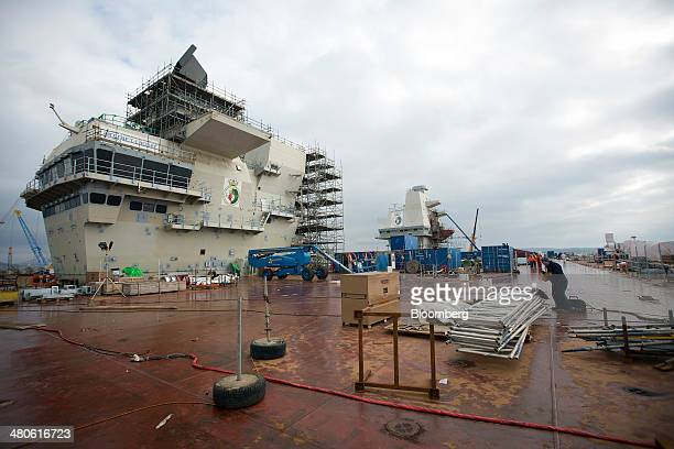 Construction equipment and scaffolding sits on the flight deck of the Royal Navy's new Queen Elizabeth class aircraft carrier manufactured by the...