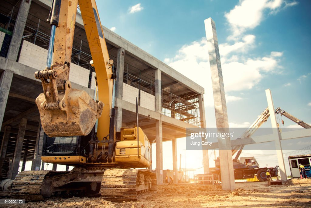 construction equipment in construction new warehouse background : Stock Photo