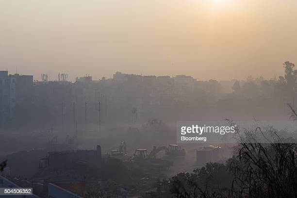 Construction equipment sits idle at a site shrouded in smog in New Delhi India on Monday Jan 11 2016 A 2judge Delhi High Court panel headed by Chief...