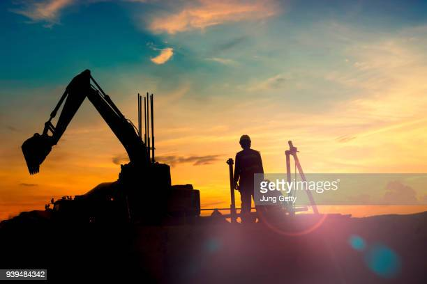 construction equipment's silhouette on sunset - gruva bildbanksfoton och bilder