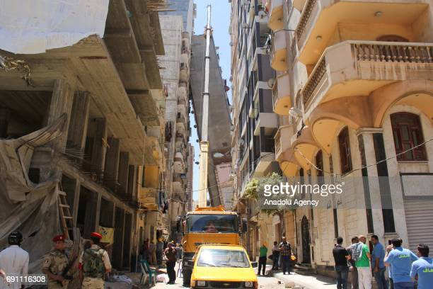 Construction equipments work at at the area after 12storey apartment building toppled over another building in Alexandria Egypt on June 1 2017