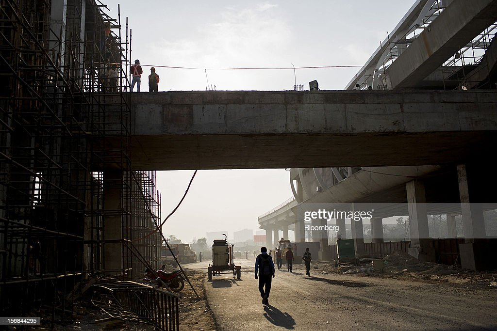 Construction for a new Rapid MetroRail Gurgaon Ltd. station stands in Gurgaon, India, on Wednesday, Nov. 21, 2012. Indian Prime Minister Manmohan Singh aims to spur spending on infrastructure to revive a faltering economy and tackle bottlenecks contributing to one of Asia's highest inflation rates. Photographer: Brent Lewin/Bloomberg via Getty Images