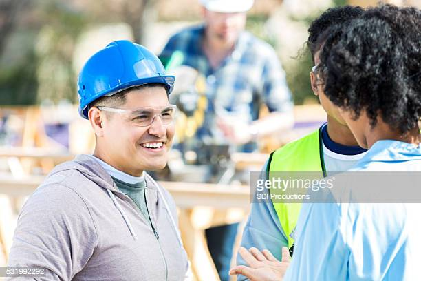 Construction foreman meets with home builder