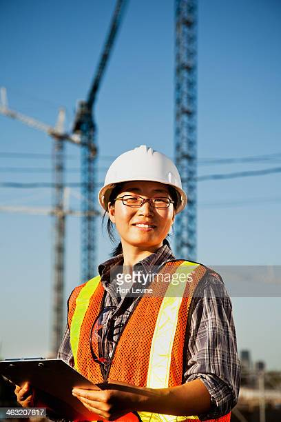 Construction forewoman with clipboard, portrait