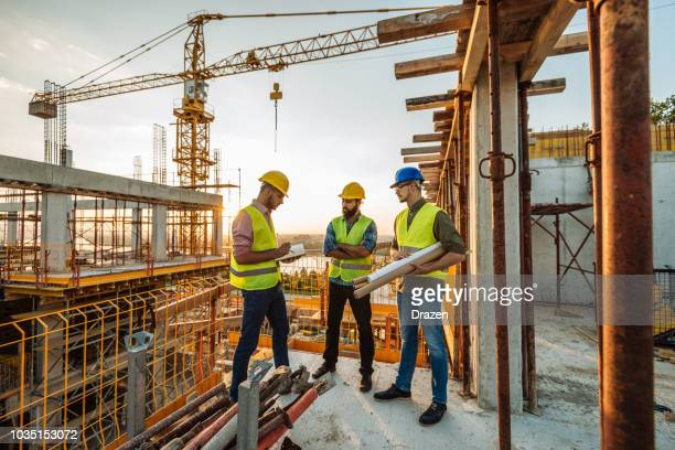 construction industry - architects and engineers working together - construction industry stock pictures, royalty-free photos & images