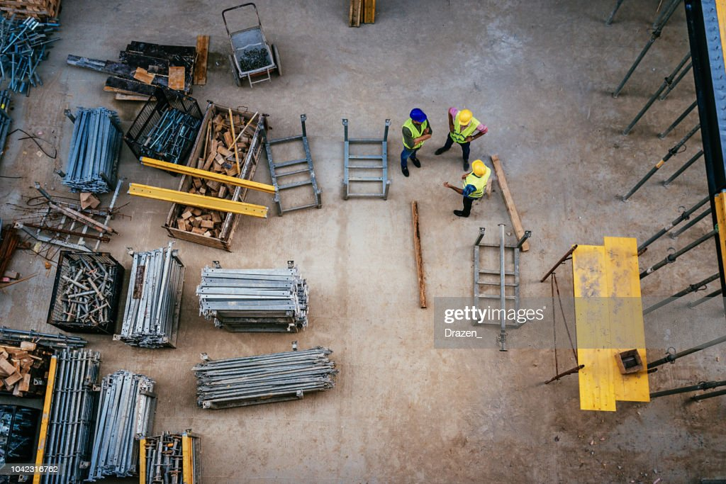 Construction industry - architects and engineers working together : Stock Photo