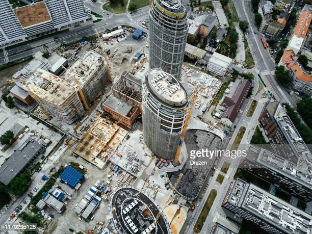 construction industry - building skyscrapers in downtown, construction site seen from above - slovakia stock pictures, royalty-free photos & images