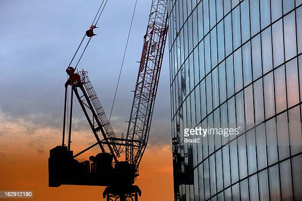 construction industry - crane construction machinery stock pictures, royalty-free photos & images