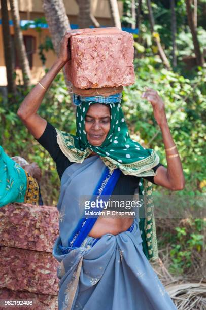 Construction industry - Woman brick carrier, builder, Kerala, India