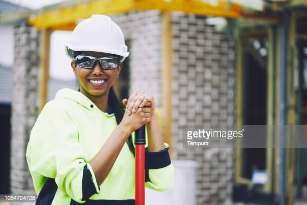 construction industry worker looking at camera portrait. - protective eyewear stock photos and pictures