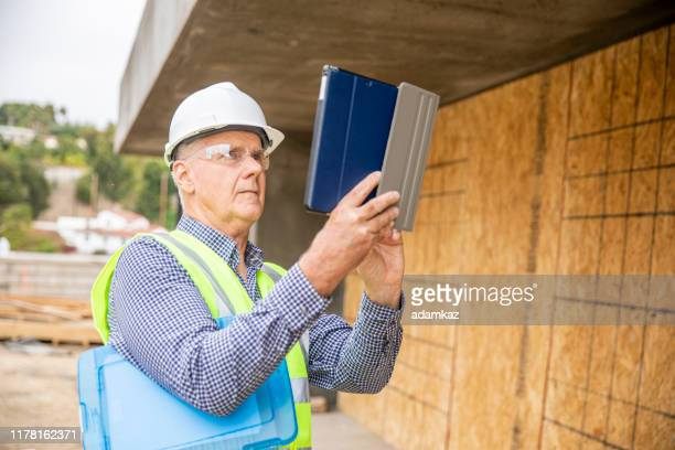 construction inspector photographing - quality control stock pictures, royalty-free photos & images
