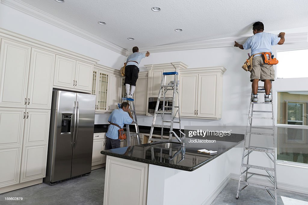 Construction: Installing crown molding : Stock Photo