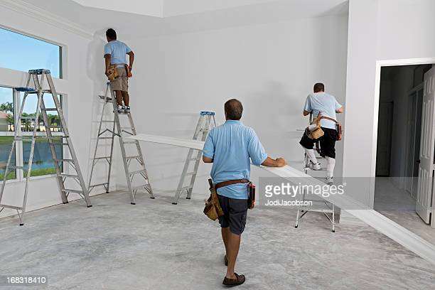 construction: installing crown molding - crown molding stock photos and pictures