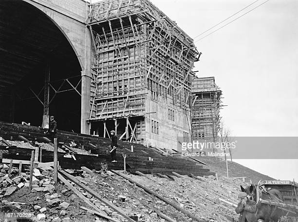 Construction is under way on the two towers at Wembley Stadium 14th February 1924 Stairways are being built within the towers to enable latecomers to...