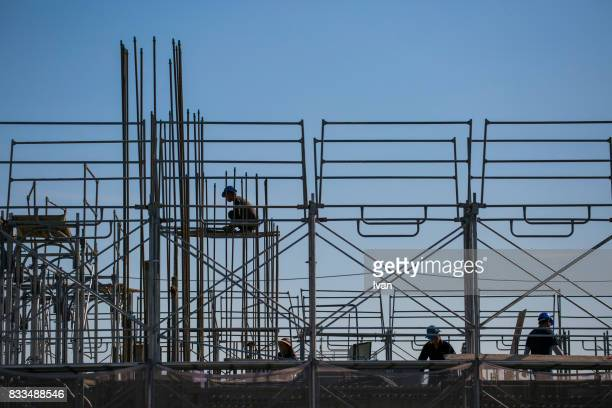 Construction laborer, builder, building worker in dangerous aerial, high area