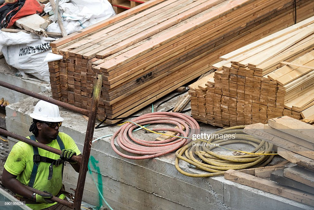 a construction laborer works on the site of a new residential building in the hudson yards