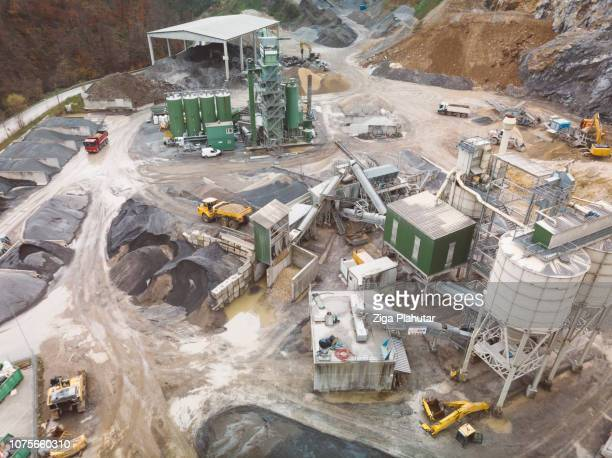 construction machinery in a quarry - helicopter photos stock pictures, royalty-free photos & images