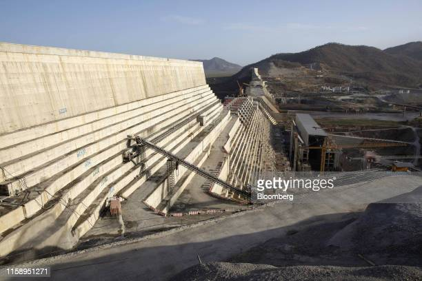 Construction machinery stands on the side of the dam wall at the site of the under-construction Grand Ethiopian Renaissance Dam in the...
