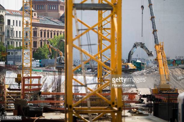 Construction machines are pictured on a construction site on April 24, 2019 in Berlin, Germany.