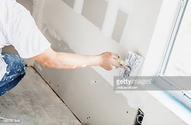 construction: man installing plasterboard - installing stock pictures, royalty-free photos & images