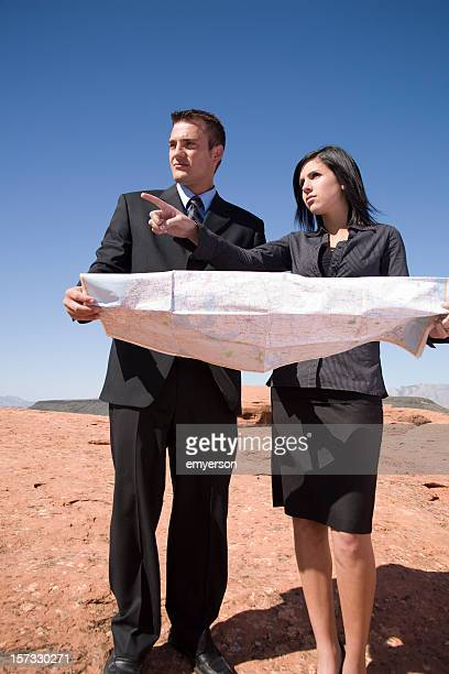 Construction manager and architect pointing at a job site
