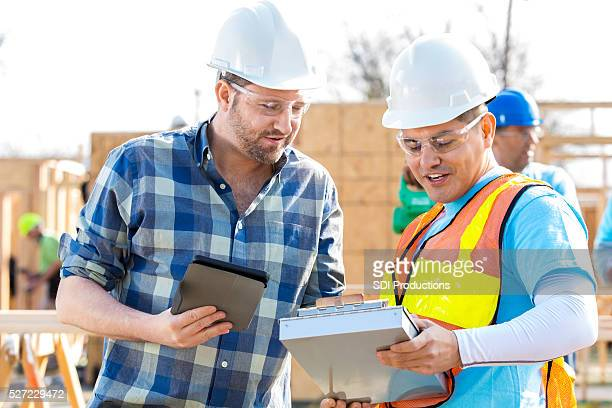 Construction managers discuss building plans