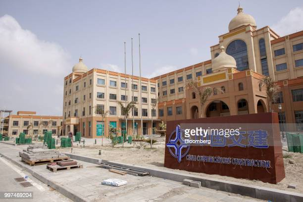 Construction materials sit next to a sign outside China Communication Construction building in the Gwadar Free Zone operated by China Overseas Ports...