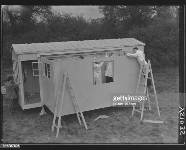 Construction men assemble the prefabricated aluminium sections of a Terrapin house which is designed to provide instant accommodaton for industrial...