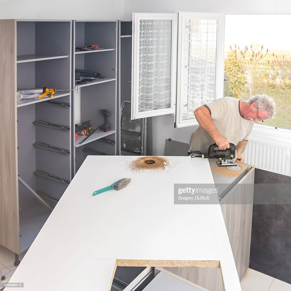 Construction Men Making Kitchen Island Hole Stock Photo Getty Images - Making a kitchen island