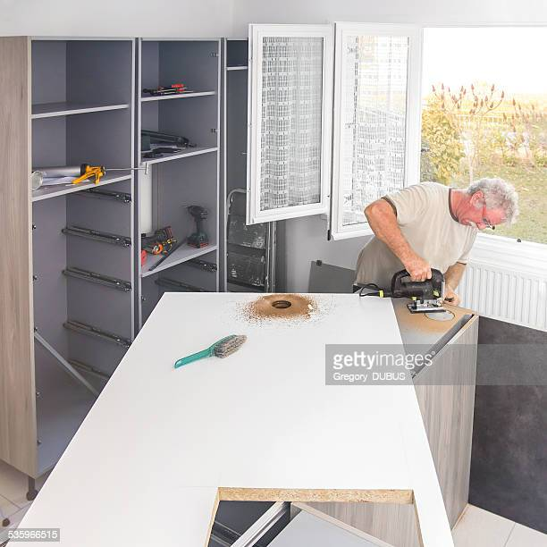 Construction men making kitchen island hole